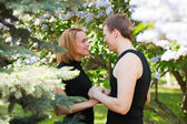 Happy young couple in a spring garden — Stock Photo