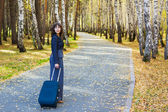 Young businesswoman with suitcase — Stok fotoğraf