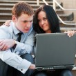 Young couple with laptop — Stock Photo #6417929