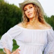 Beautiful woman in stetson - Stock Photo
