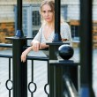 Stock Photo: Sad womagainst railing