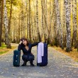 Sad woman with a luggage — Stock Photo