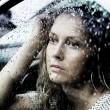 Royalty-Free Stock Photo: Sad woman and a rain