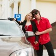 Young couple with a new car — Foto de Stock