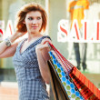 Happy shopper on a city street — Stock Photo #6419876