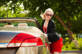 Young woman with a convertible — Stock Photo