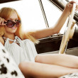 Young woman in a retro car — 图库照片