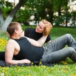 Happy young couple in a city park — Stock Photo