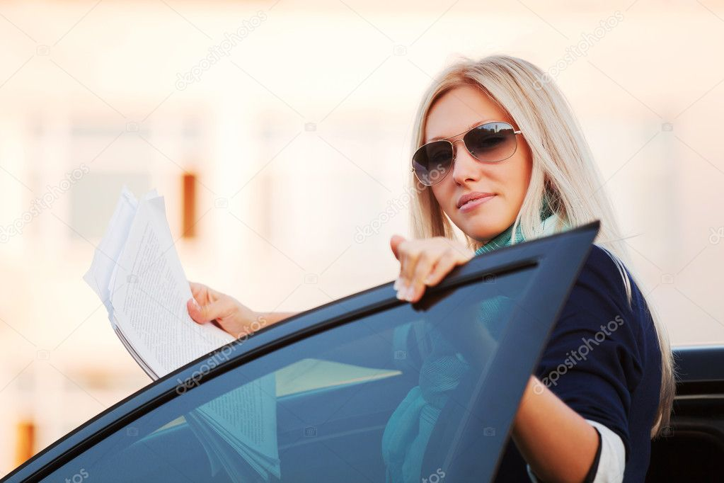 Young businesswoman with financial reports — Stock Photo #6423017