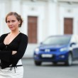 Young woman against a car parking — Stock Photo