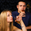 Young couple relaxing in a bar — Stock Photo