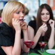 Two young women eating a dessert — Stock Photo