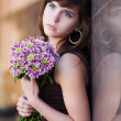 Sad young woman with chrysanthemums — Stock Photo #6446094