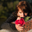 Sad young woman with a rose — Stock Photo #6446101
