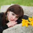 Young woman lying on the tombstone — Stock Photo #6446103