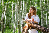 Young woman on nature — Stock Photo