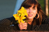 Happy young woman with a lily — Stock Photo