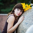 Young woman with yellow lily — Stock Photo #6477682