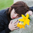 Young womlying on tombstone — Stockfoto #6477696