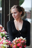 Beautiful woman on the porch — Stock Photo
