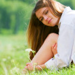 Young woman relaxing on nature — Stock Photo