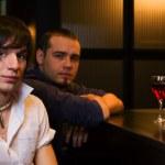 Young men relaxing in a night bar — Stock Photo #6554679