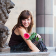 Happy young woman with a red rose — Stock Photo #6557523