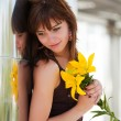 Happy young woman with a lily — Stock Photo #6557542