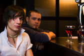 Young men relaxing in a night bar — Stock Photo