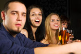 Young relaxing in a night bar — Stock Photo