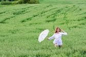 Happy woman with umbrella — Stock Photo