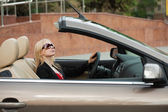 Young woman driving a convertible — Foto Stock