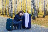 Sad businesswoman with a luggage — Stock Photo
