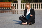 Young businesswoman with a folder — Stock Photo