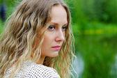 Sad young woman on nature — Stock Photo