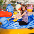 Teenage girl having fun in a water park — Stock Photo