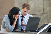 Young couple working on laptop — Foto Stock