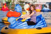 Teenage girl having fun in a water park — Stock Photo