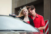 Happy young couple with a new convertible car — Stock Photo