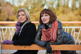 Two young women on a bench — Stock Photo