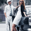Young couple with a retro car — Stock Photo #6608900