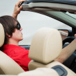 Young womdriving convertible — Stock Photo #6653280