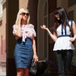 Two young women walking on a city street — Stock Photo #6653304