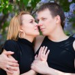 Happy young couple in a city park — Stock Photo #6666839