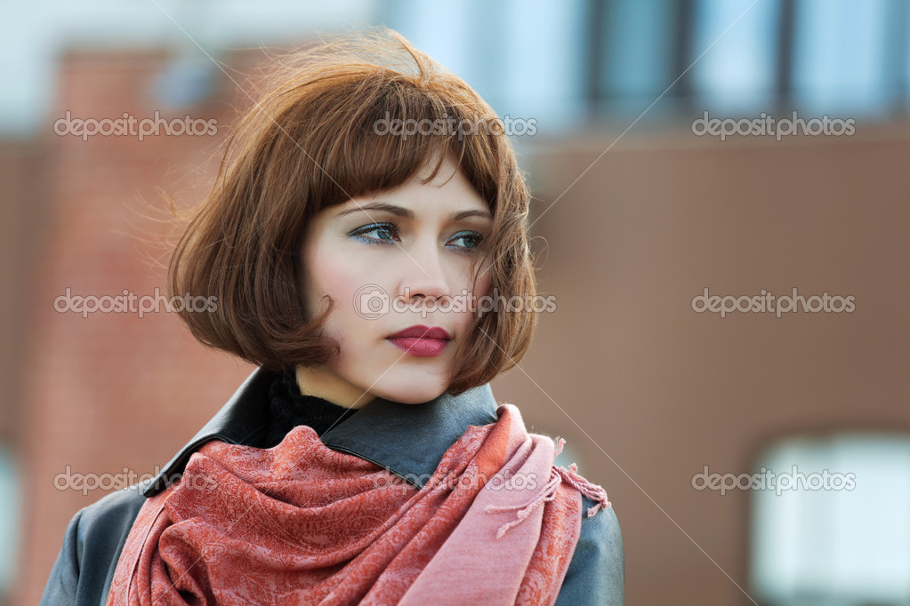 Thoughtful young woman on the city street — Stock Photo #6666791