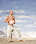 Spiritual Man with Ball of Light Practises Tai Chi — Stock Photo