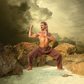 Powerful Young Man Trains in Karate — Stock Photo