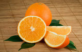 Fresh oranges with leaves — Stock Photo