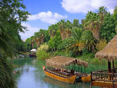 Landscape and walking canoe on river in French Polynesia. — Stock Photo