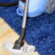 The metal pipe of vacuum cleaner in action -clean a carpet and floor — Stock Photo